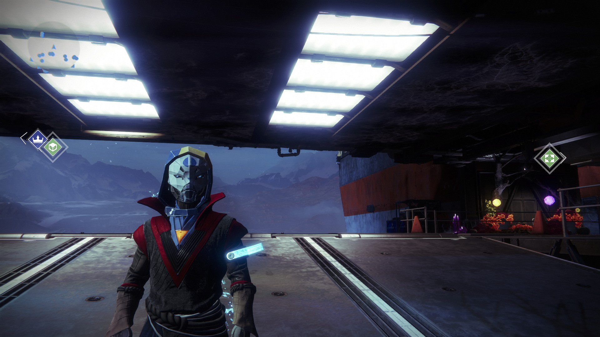 A character standing in the tower wearing a mask like a hooded robot person